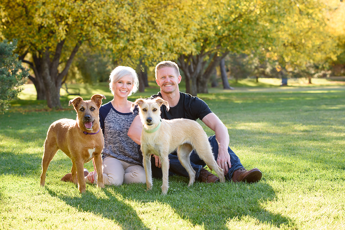 Couple with two dogs at park