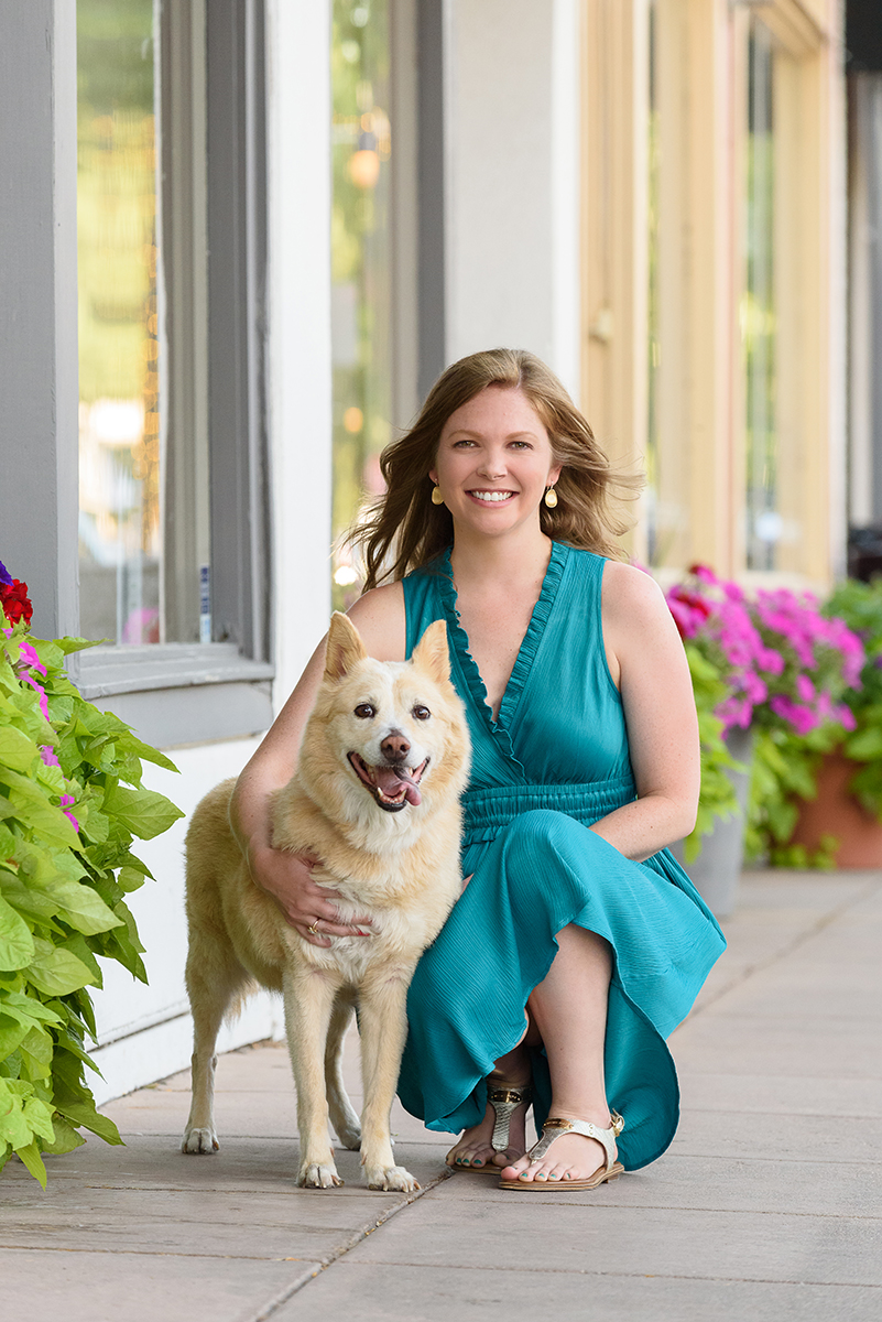 Dog and woman posing for portrait