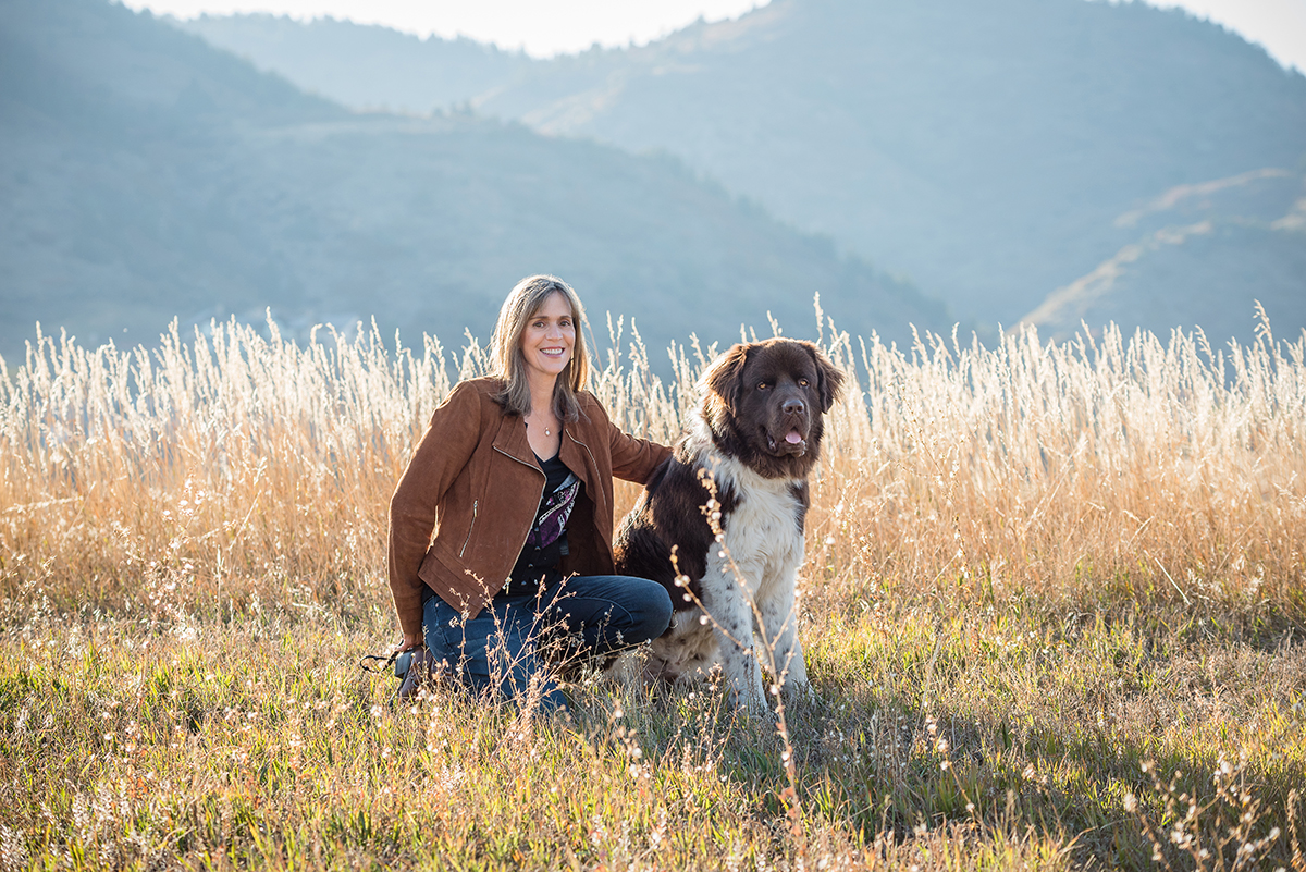 Newfoundland dog and owner by mountains