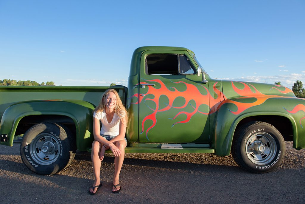 Women by vintage truck during a photo session
