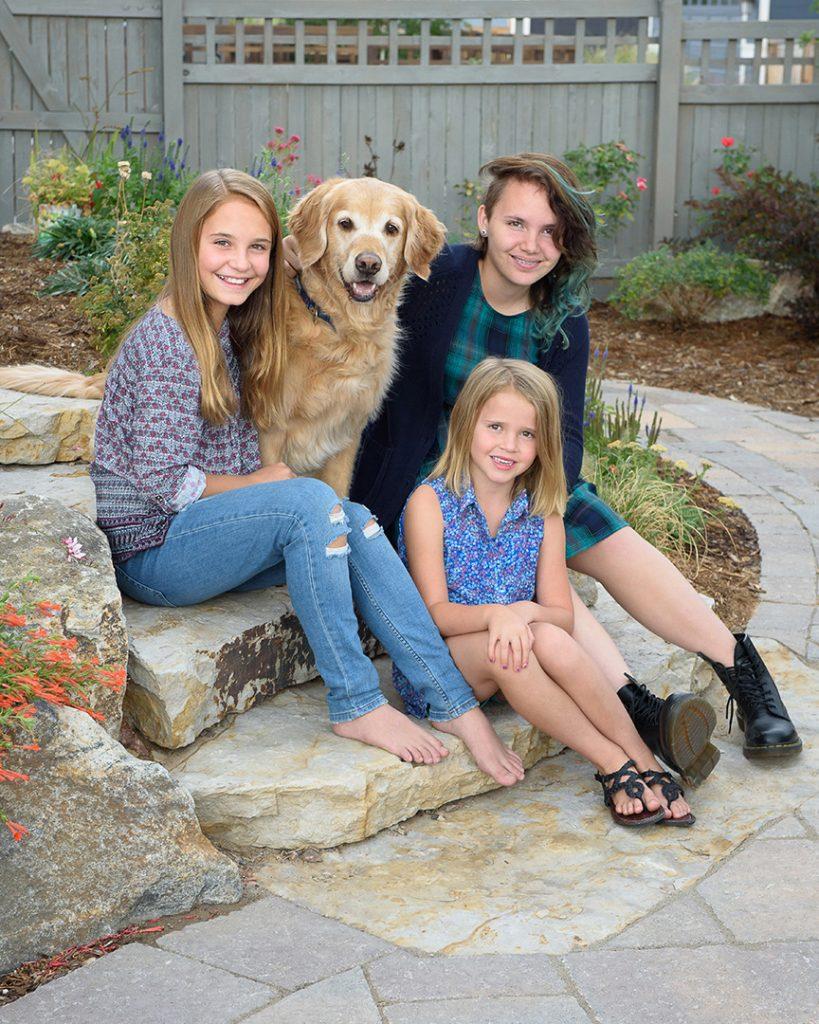 Child Portrait with golden retriever dog