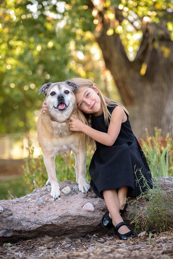 Girl with Puggle dog