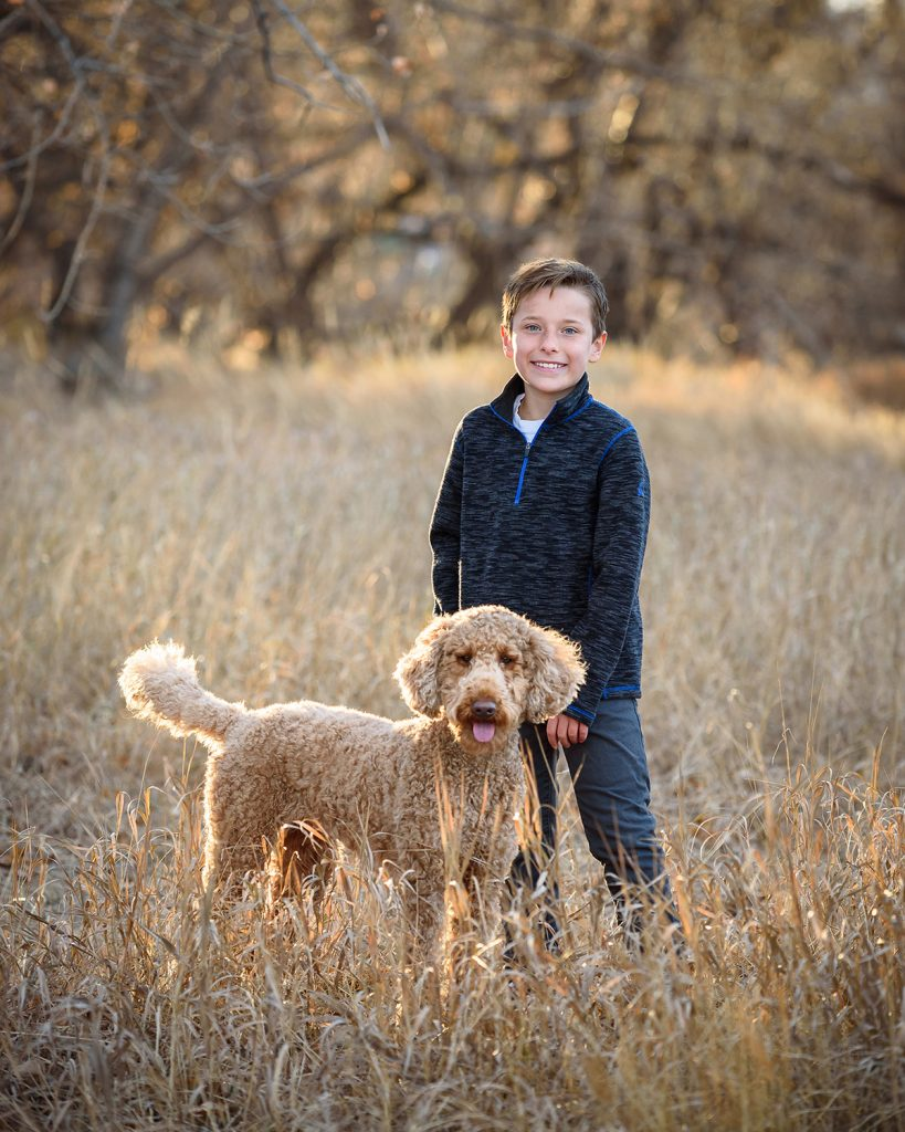 Goldendoodle dog with boy during one of my off-season dog photos